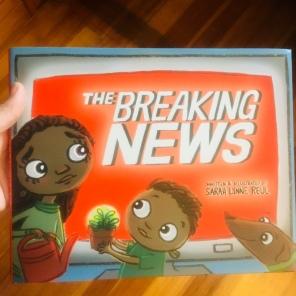 Breaking News in hand